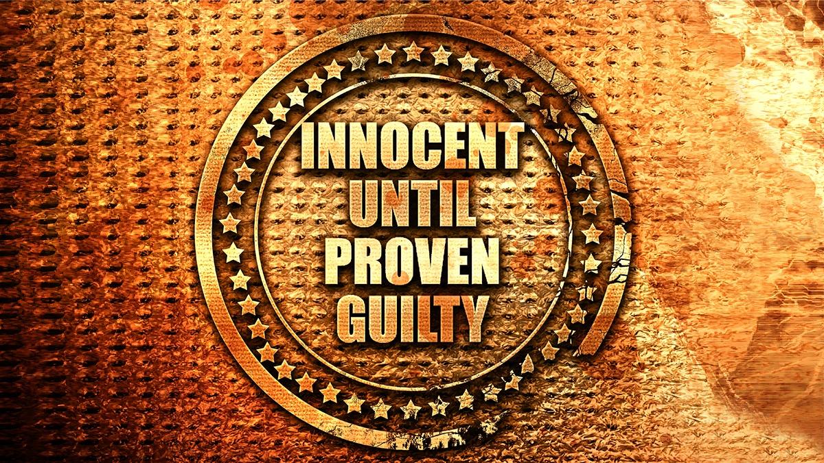"embossed emblem saying ""Innocent Until Proven Guilty"""