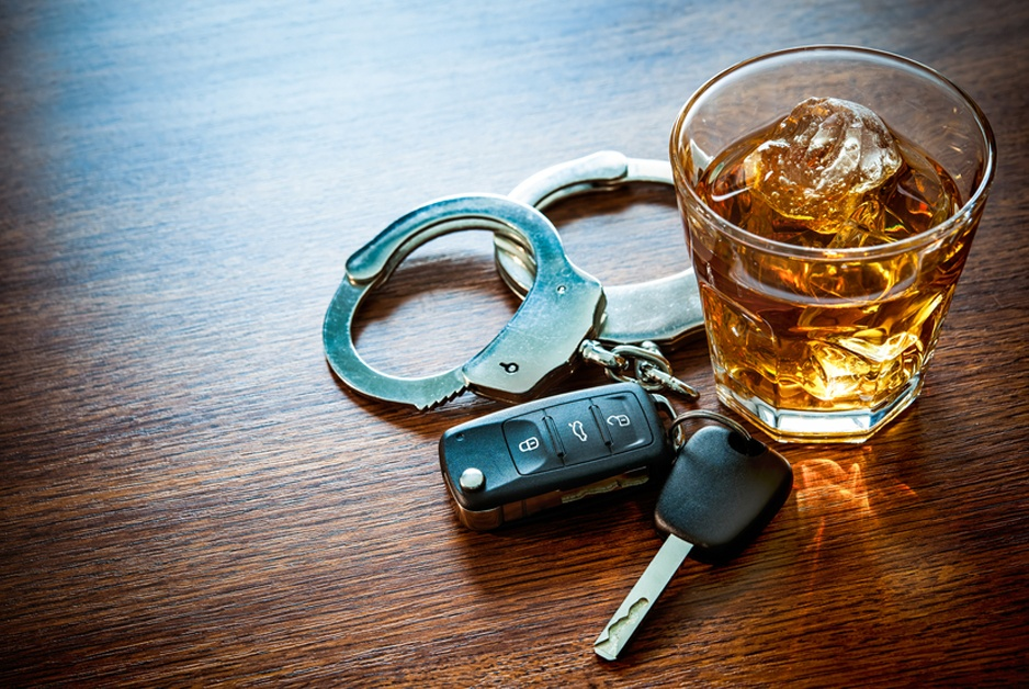 keys, cuffs, drink symbolize need to avoid drunk driving arrest