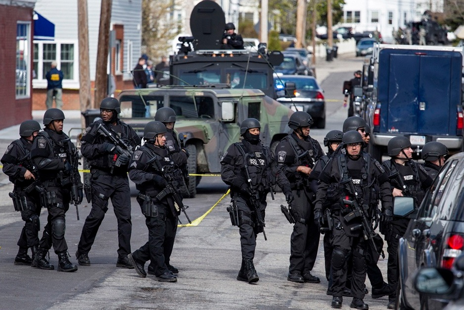 police wearing armor, armored vehicles, signifying police state