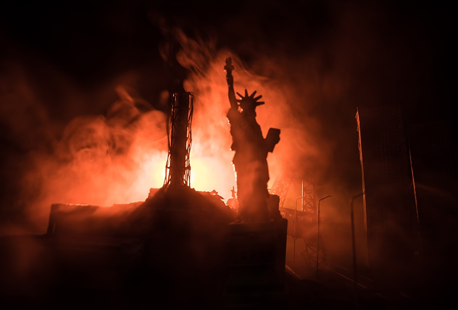 image of statue of liberty against backdrop of a city destroyed