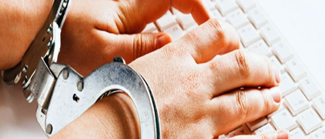 handcuffs while using keyboard signify restriction of Freedom of speech for bloggers