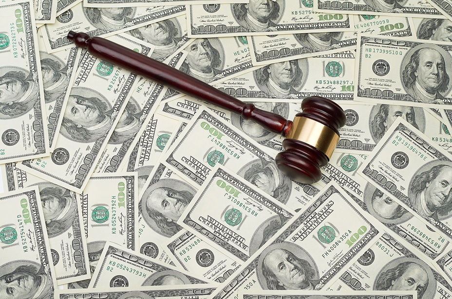 gavel on money signifies that crime pays