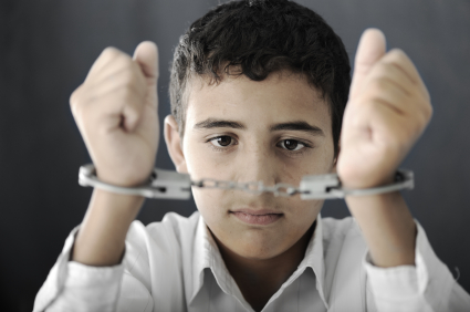 Child in handcuffs