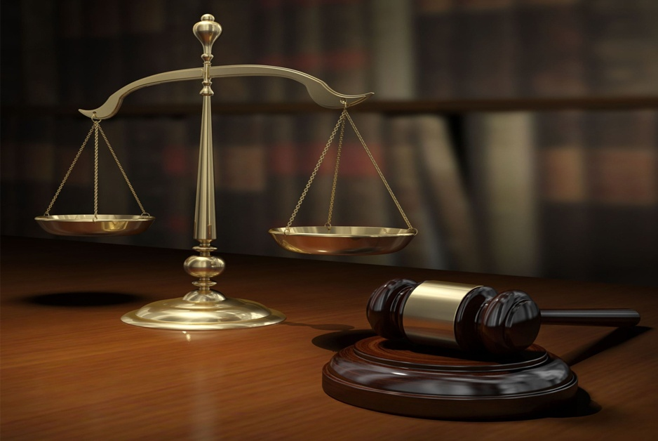gavel and scales of justice signify justice and law