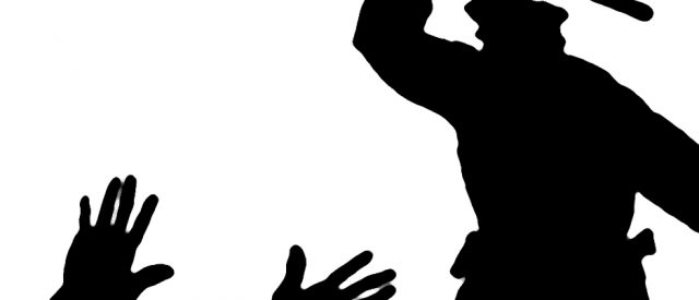 Police beating man (silhouette)
