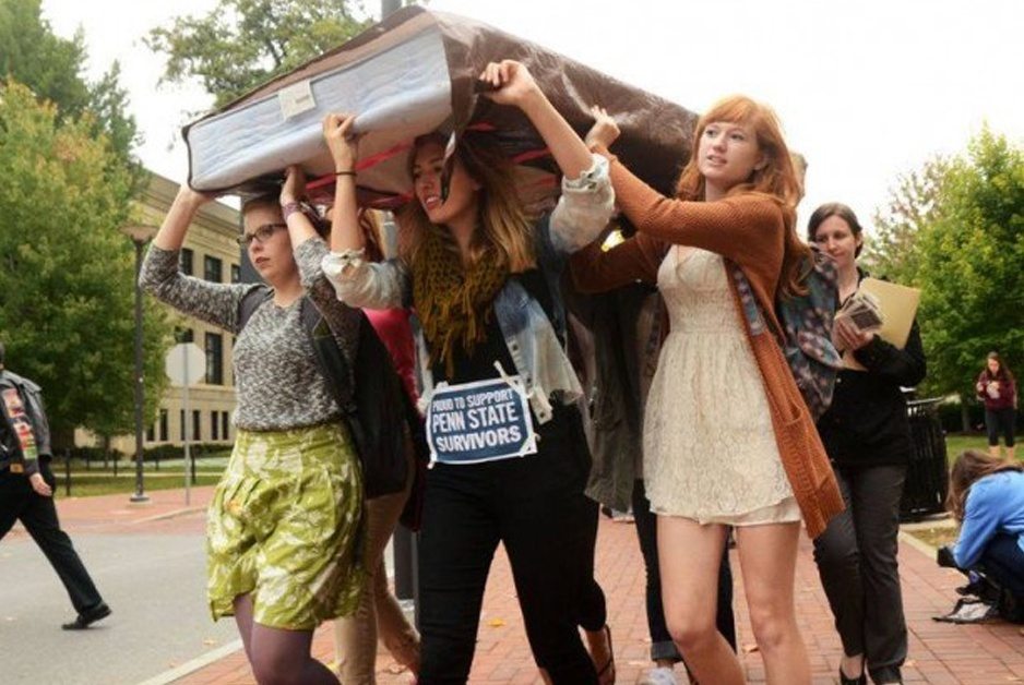 women students carrying mattress to protest requiring proof of rape for colleges