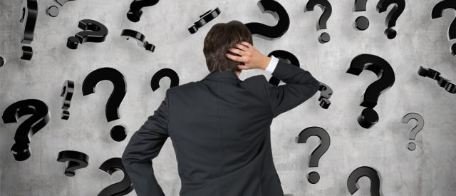 confusion shown by facing wall of question marks
