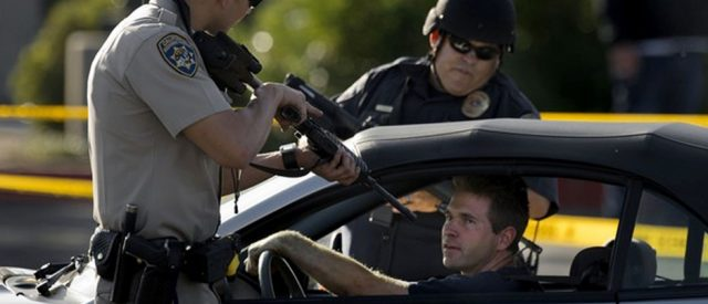 Cop holds gun on citizen during roadblock search of all cars in area