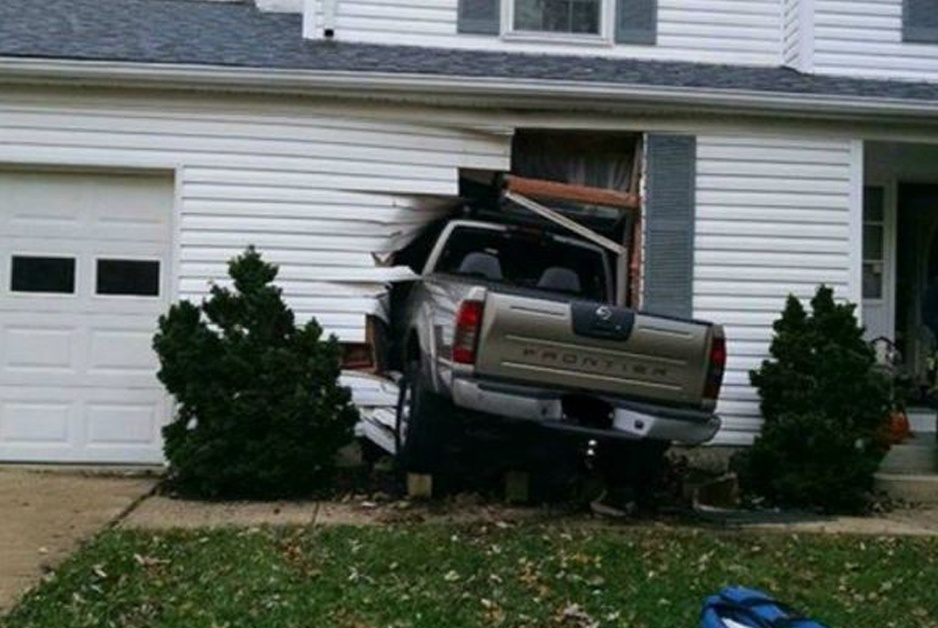 image of truck being big buttinski by crashing into house