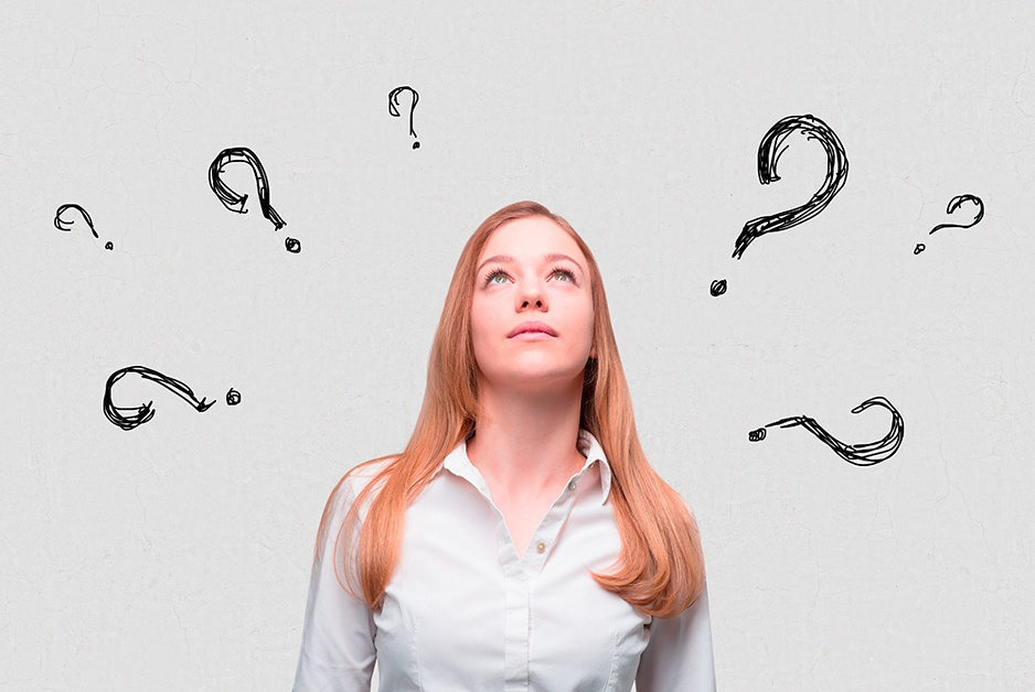 internet questions with question marks showing above woman's head