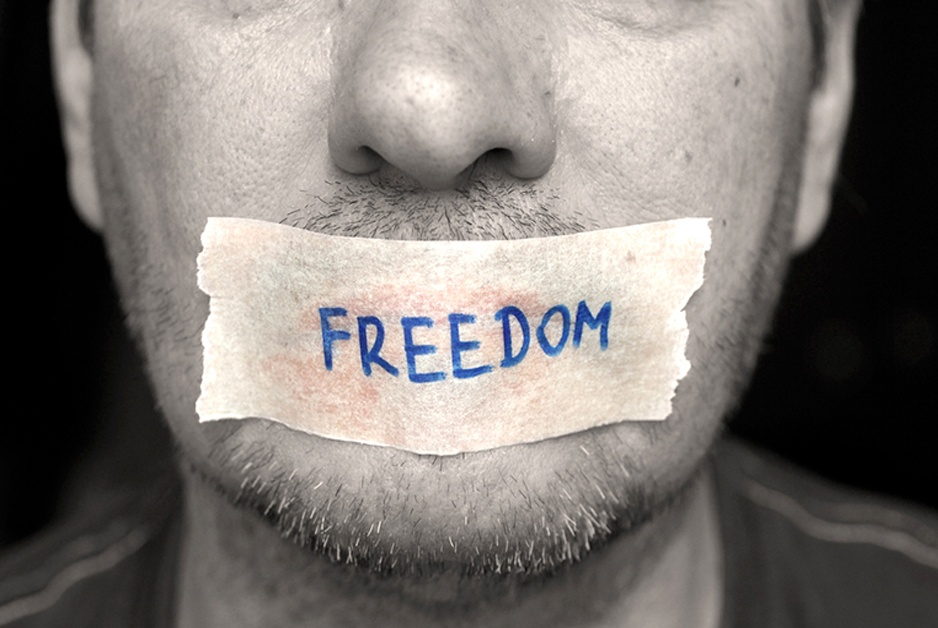 W(h)ither Freedom of Speech mumbles the man with mouth taped shut