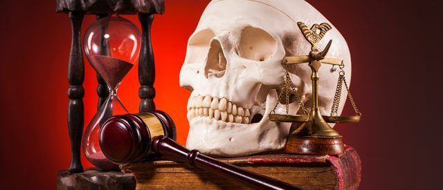 skull, gavel, sand timer, book symbols of the executioners