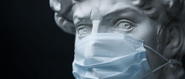 classical statue wearing mask to prevent coronavirus infection