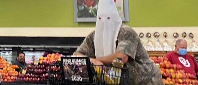 wearing mask during grocery shopping to demonstrate he has a sickness worse than coronavirus