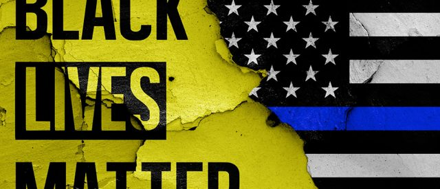 mash-up of black lives matter banner and blue lives version of american flag to denote race and law in america