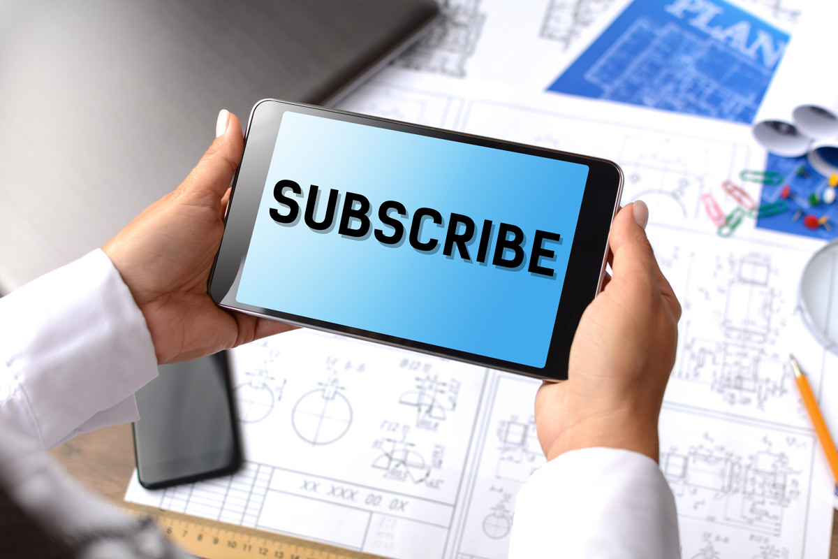 "picture of hands holding tablet that says ""subscribe"""