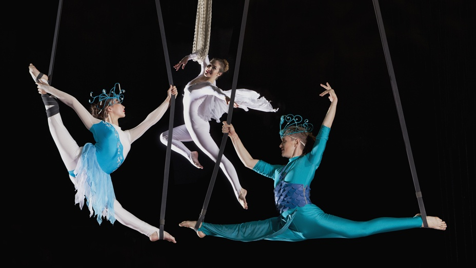 image of three trapeze dancers at a circus to show the totality of the circus dances