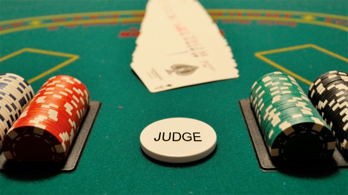 gambling table with house chip labeled judge designates the stacked deck
