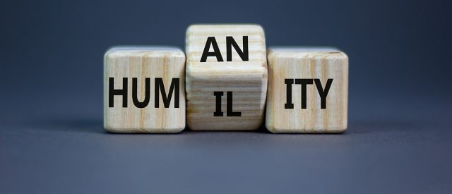 lettered dice alternately spell out humility and humanity because it is through humility we find humanity
